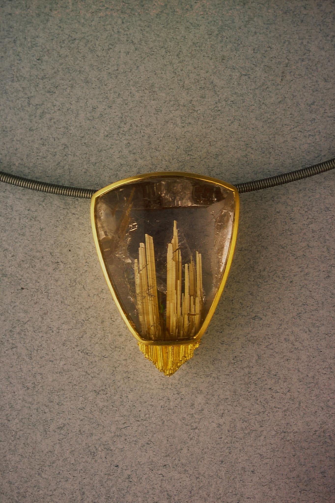 Rutile quartz cabochon, gold 18 & 22 Kt., niobium cable with gold bayonet clasp.